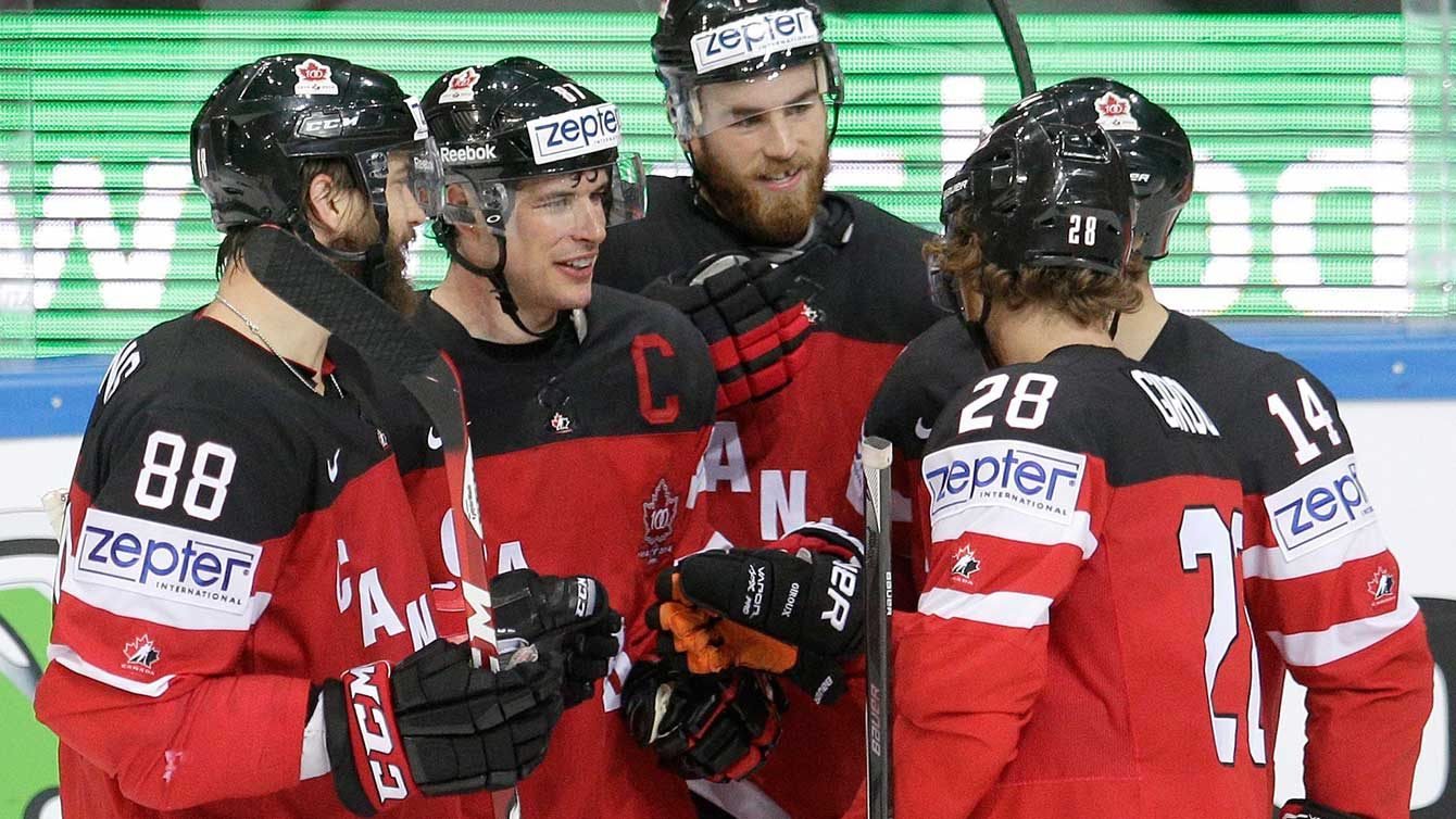 Sidney Crosby (with 'C' on shirt) and team celebrate at IIHF worlds.
