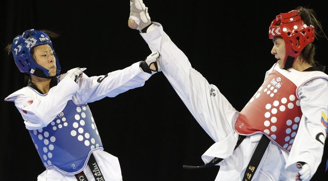 Canada's Yvette Yong fights Colombia's Ibeth Rodriguez during a women's -49kg quarterfinal taekwondo match at the Pan Am Games in 2015