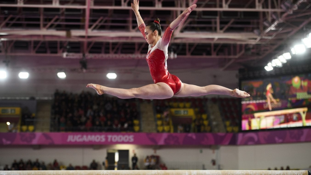 Victoria Woo of Canada competes in the balance beam portion