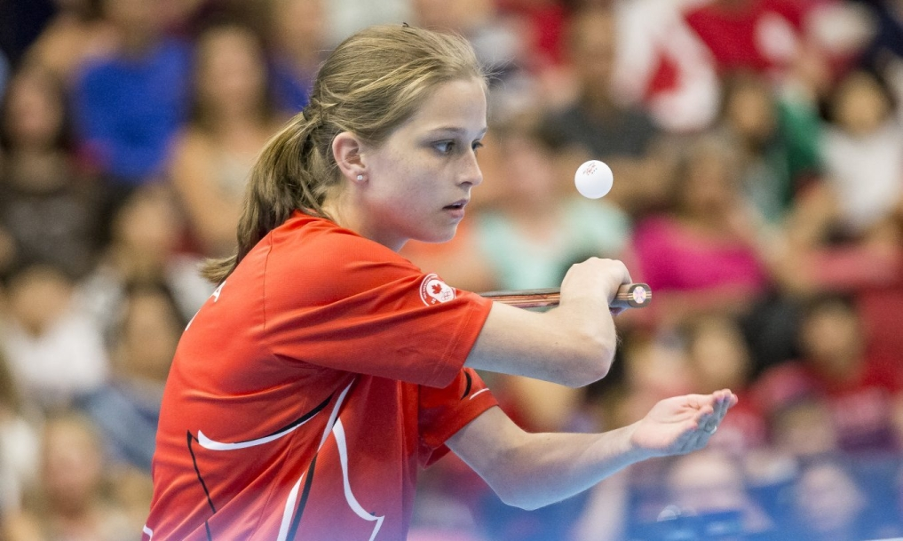 Alicia Cote serves ball