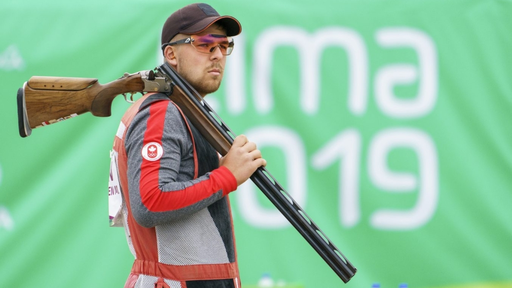 Athlete holding gun over shoulder