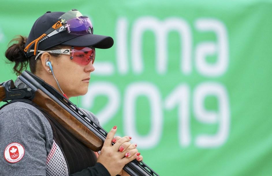 Athlete holding gun over shoulder