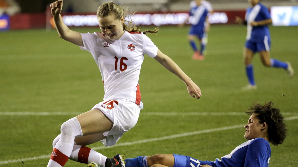 Guatemala's Didra Martinez challenges Canada's Gabrielle Carle for the ball during the second half of a CONCACAF Olympic qualifying tournament
