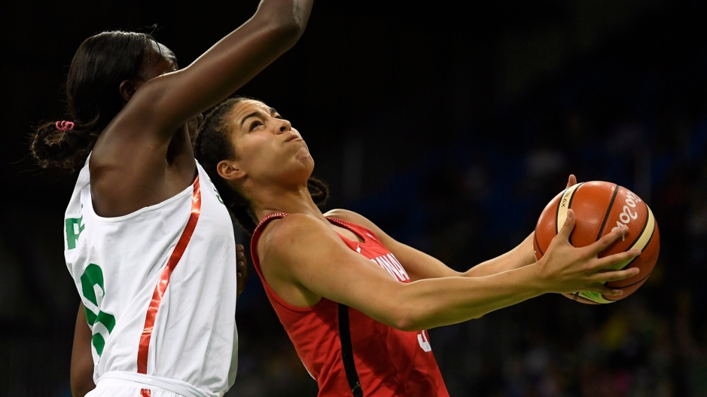 Kia Nurse backs in on a Senegalese player