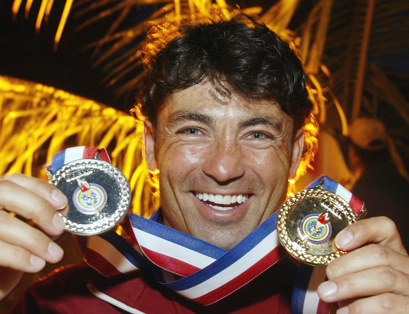Water skier Jaret Llewellyn holds up his two Pan Am medals from Santo Domingo 2003.