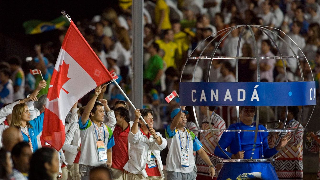 Susan Nattrass carries the Canada flag at Opening Ceremony of the Pan Am Games at Rio 2007.