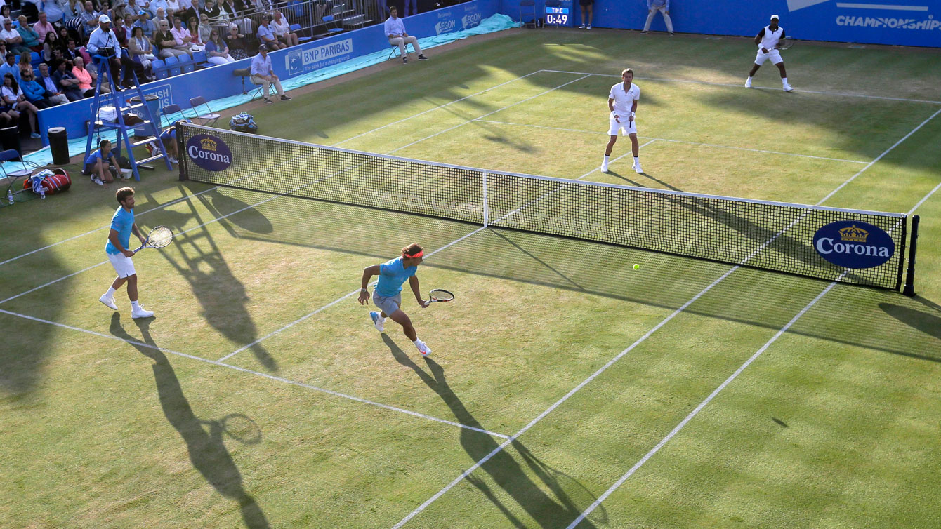 Daniel Nestor and Leander Paes (far court) against Marc Lopez and Rafael Nadal of Spain at the Queen's Championship in London on June 18, 2015.