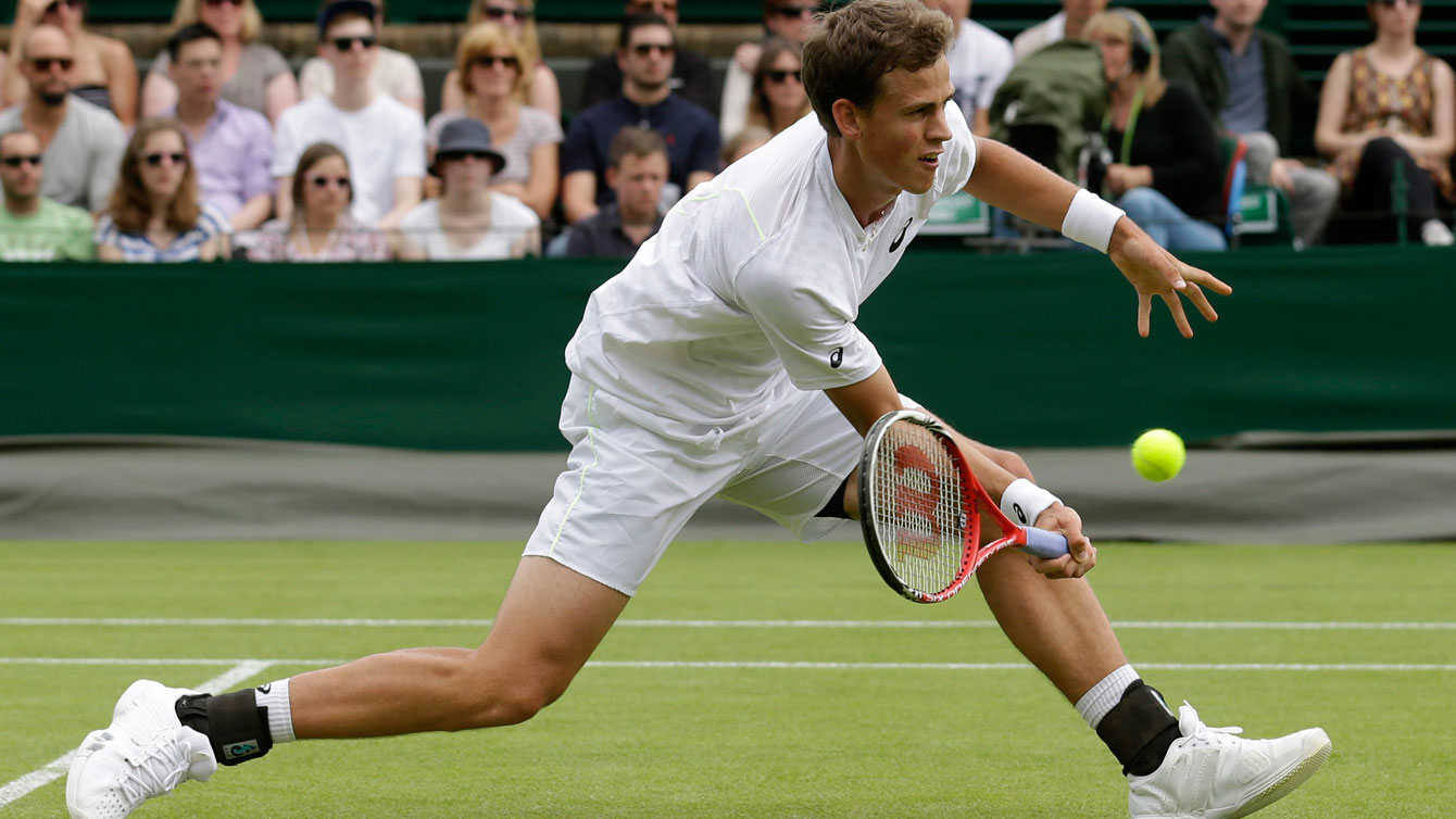 Vasek Pospisil in action at Wimbledon in 2013.