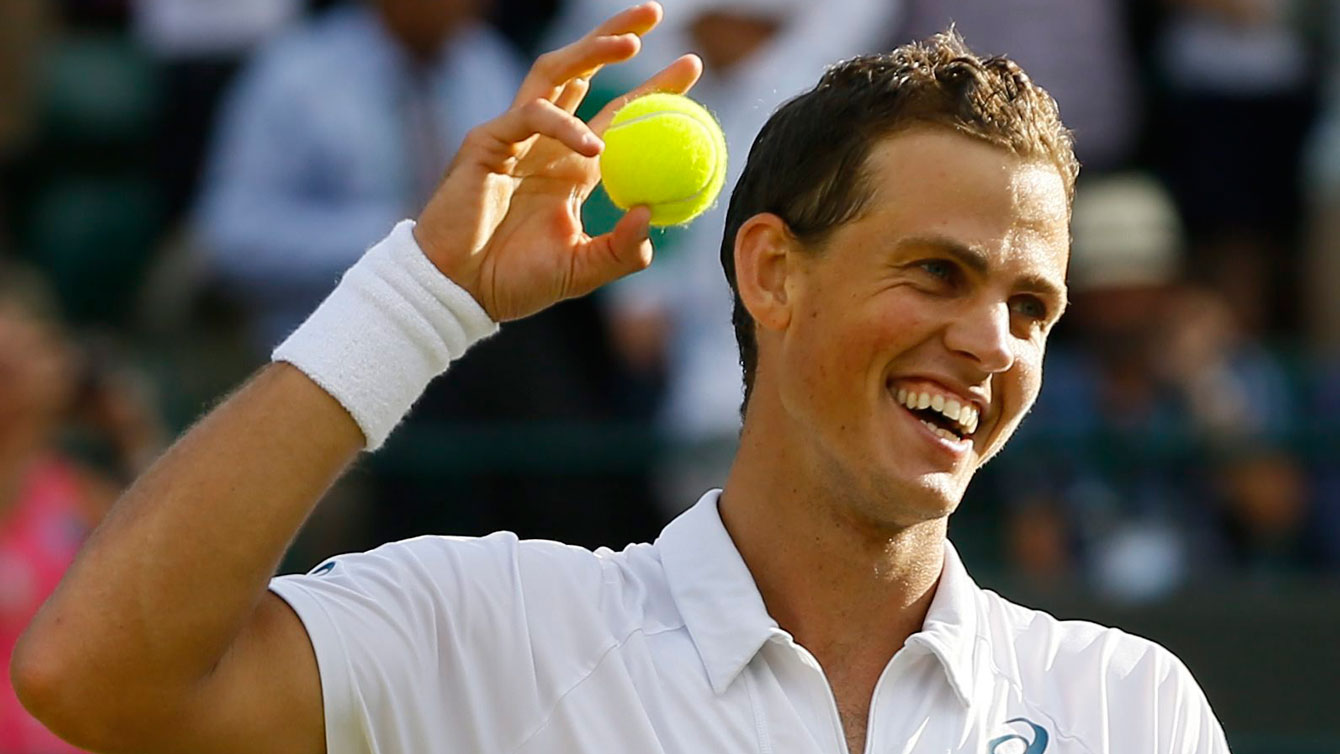 Vasek Pospisil is all smiles after defeating James Ward of Great Britain at Wimbledon on July 4, 2015.
