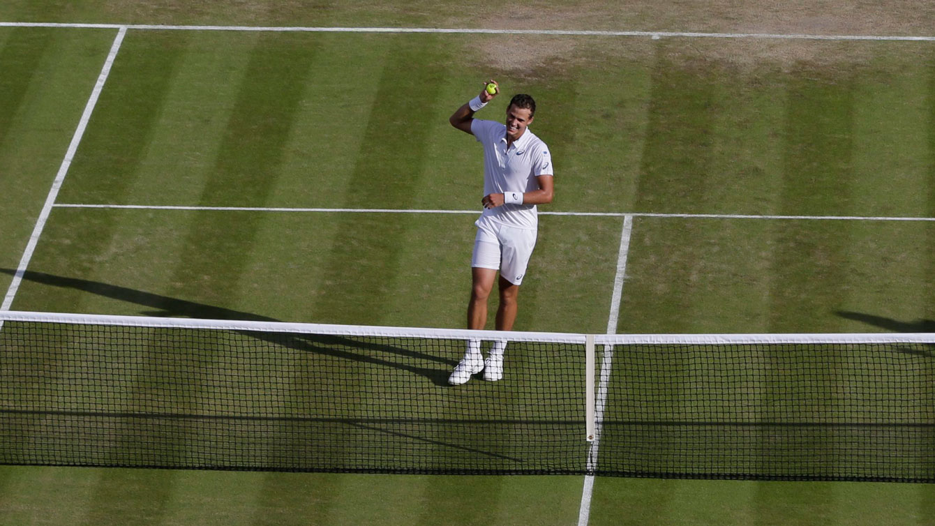 Vasek Pospisil celebrates at the net after defeating James Ward of Great Britain at Wimbledon on July 4, 2015.