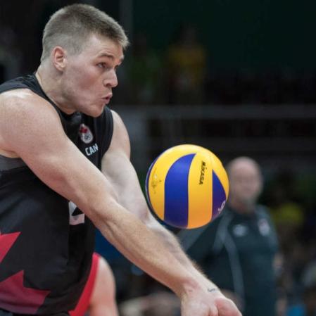 Canada's Gord Perrin bumps the ball