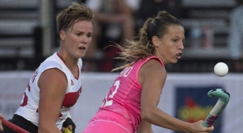 Argentina's Delfina Merino (right) bounces the ball on her stick as she takes it away from Canada's Shanlee Johnston