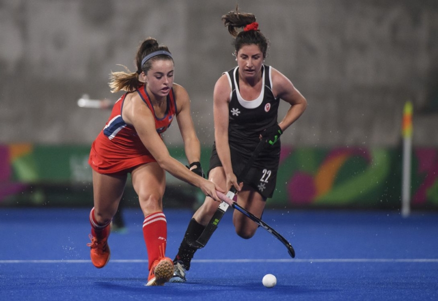 Maddie Secco battles opponent for ball