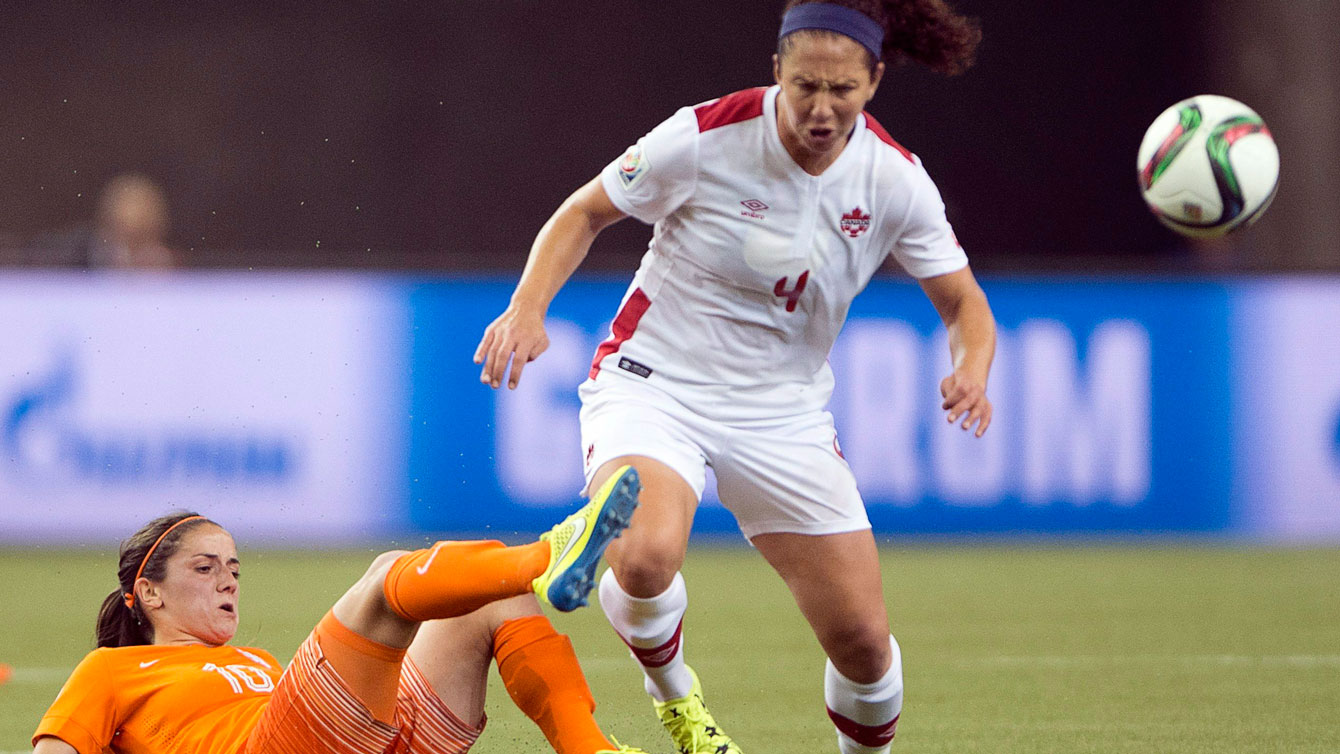 Carmelina Moscato of Canada (right) in a challenge for the ball with Danielle van de Donk of Netherlands at the FIFA Women's World Cup on June 15, 2015.