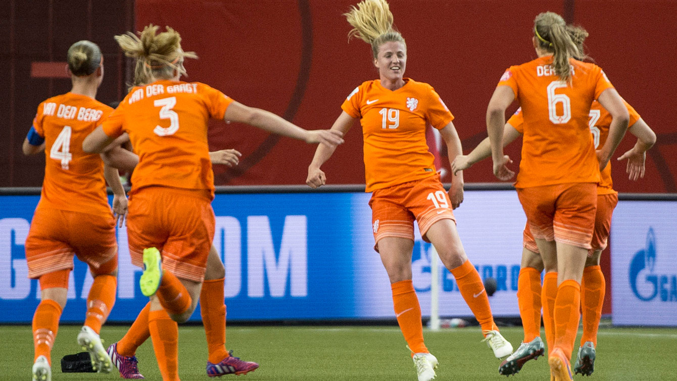 Netherlands players celebrate the Kirsten van de Ven (19) equalizer against Canada at the FIFA Women's World Cup on June 15, 2015.
