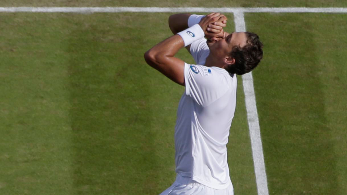 Vasek Pospisil celebrates after defeating James Ward of Great Britain at Wimbledon on July 4, 2015.