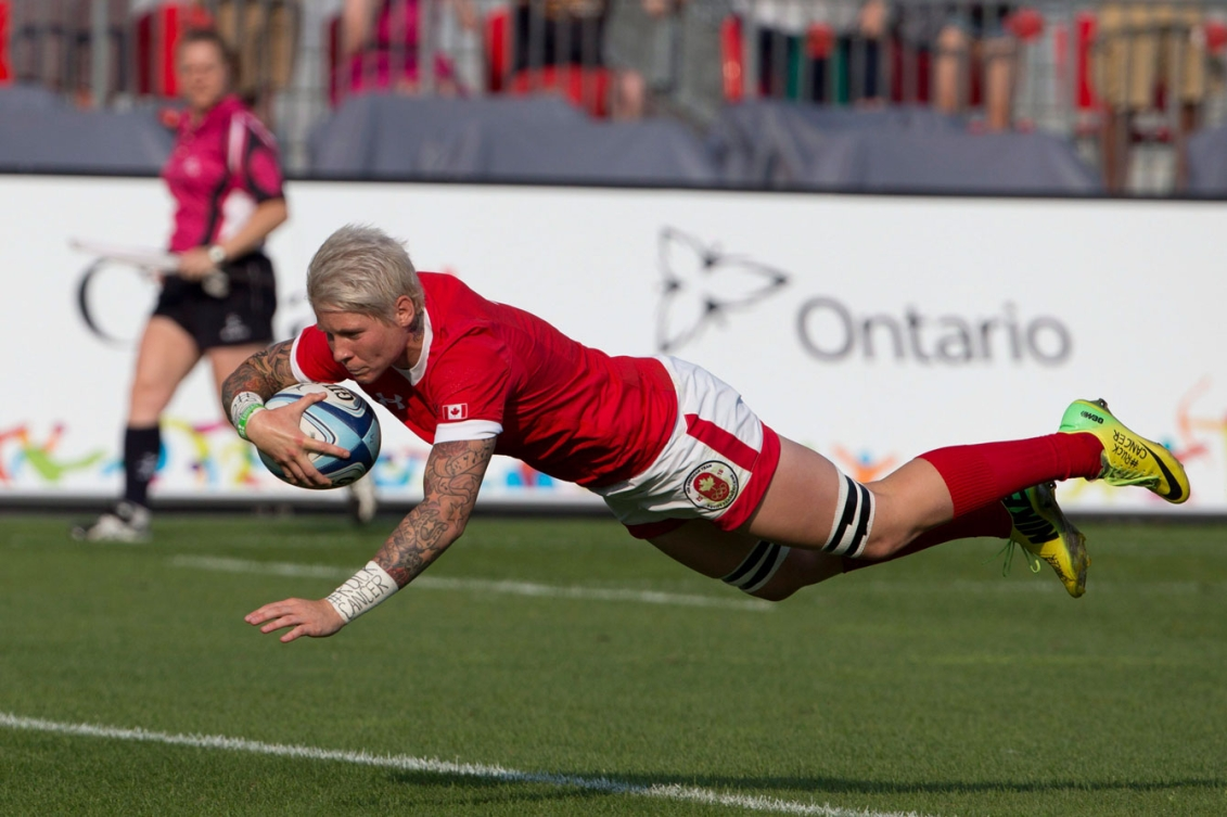 Women's team captain Jenn Kish dives for one of her many tries during the tournament. (Photo: Canadian Press)