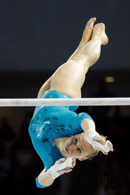 Canada's Ellie Black performs on the uneven bars during women's artistic gymnastics all-around competition in the Pan Am Games in Toronto, Monday, July 13, 2015. Black won the gold medal in the event. (AP Photo/Gregory Bull)