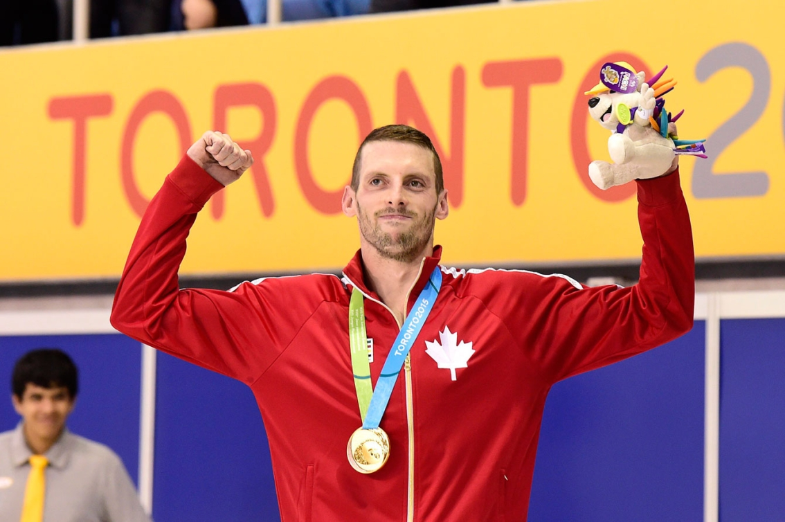 Ryan Cochrane won his 3rd medal of Toronto 2015, swimming to gold in the men's 1500m. (Photo: Canadian Press)