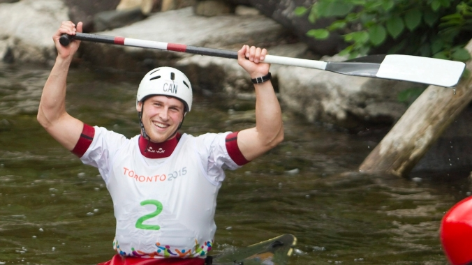 Canada's Cameron Smedley reacts after timers confirmed he won silver in Men's Solo Canoe Slalom at the Minden white water course during the Toronto 2015 Pan Am Games.