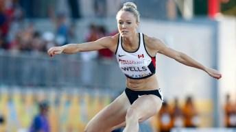 Sarah Wells competing in hurdles