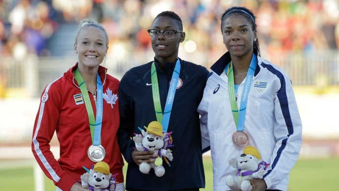 Shamier Little, Sarah Wells and Deborah Rodriguez pose on the podium