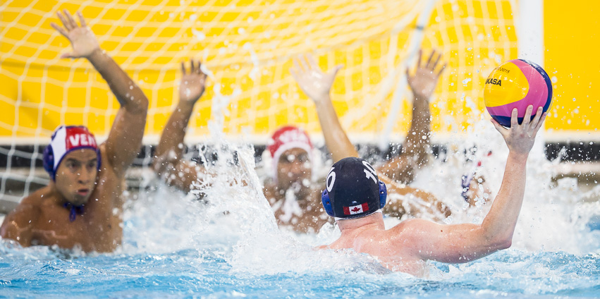 Christine Robinson (#10) doesn't get much room to shoot as Canada takes on Venezuela in a men's water polo preliminary match at the Atos Markham Pan Am/Parapan Am Centre in Markham, Ontario on July 9, 2015.