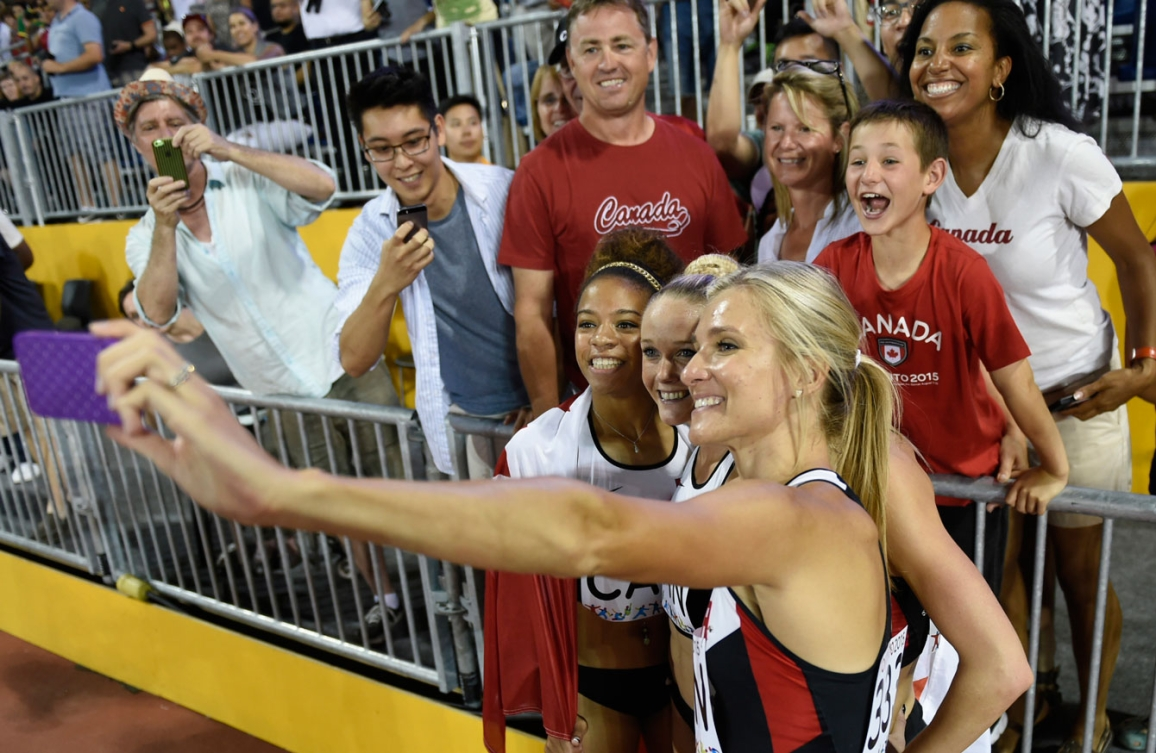 Canada's 4x400 women's team takes a selfie with fans while celebrating their TO2015 bronze from Day 15.