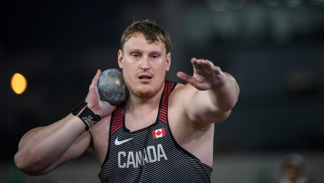 Tim Nedow with shot put by neck