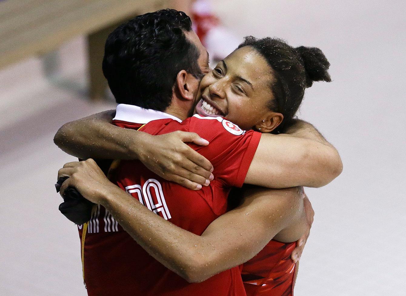 Jennifer Abel hugs coach Arturo Miranda after winning 3m gold at TO2015.