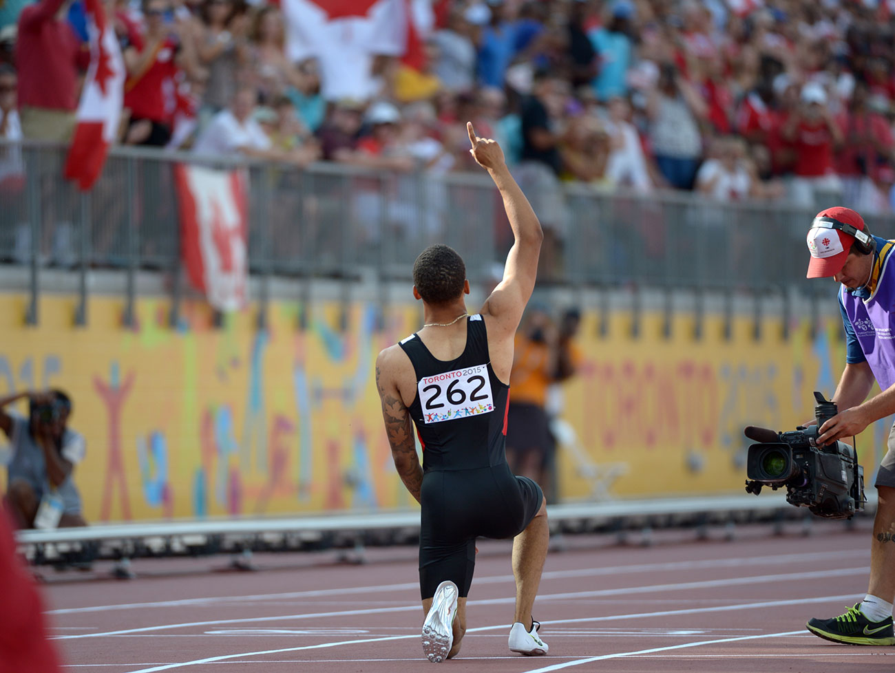 Andre De Grasse celebrates after his 200m Pan Am Games win in Toronto on July 24, 2015.