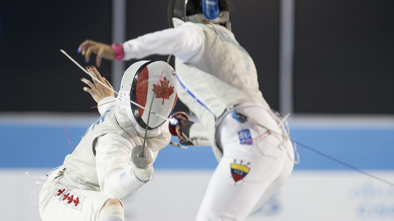 Fencer with Canadian flag on uniform