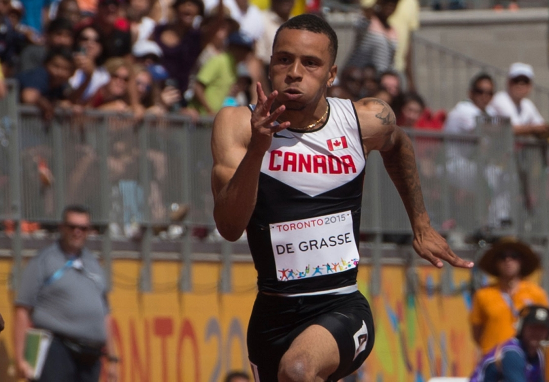 Andre De Grasse took gold in the men's 100m on Day 13 of Toronto 2015.