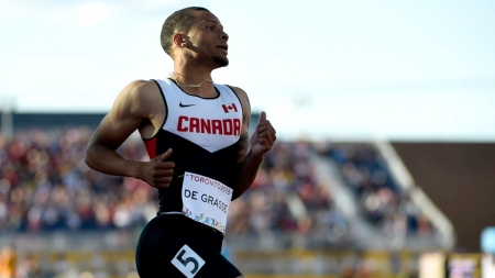 Andre De Grasse competes in the men's 100m.