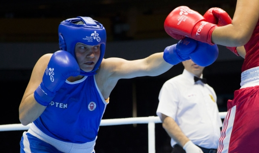 anadian Ariane Fortin, left, punches Yenebier Guillen Benitez, of the Dominican Republic, in round two the women's middle (69-75kg) semi-final bout during 2015 Pan Am Games boxing action in Oshawa, Ontario on Tuesday, July 21, 2015.
