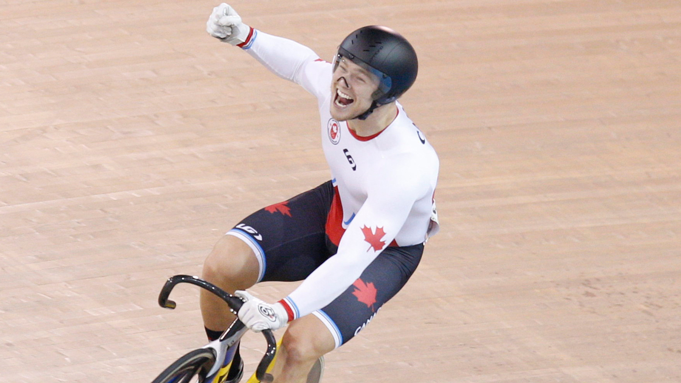 Hugo Barrette celebrates winning gold at the Pan Am Games in men's sprint on July 18, 2015.