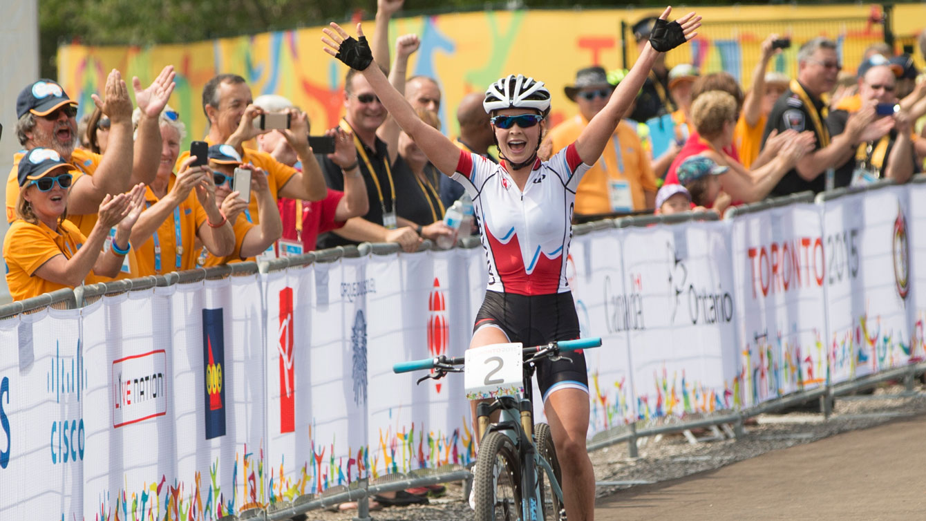 Emily Batty celebrates after winning Pan Am Games mountain bike race on July 12, 2015.