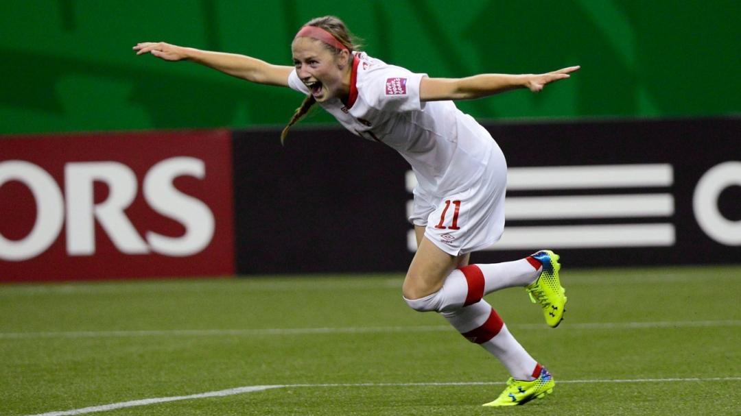 Janine Beckie celebrates after scoring a goal