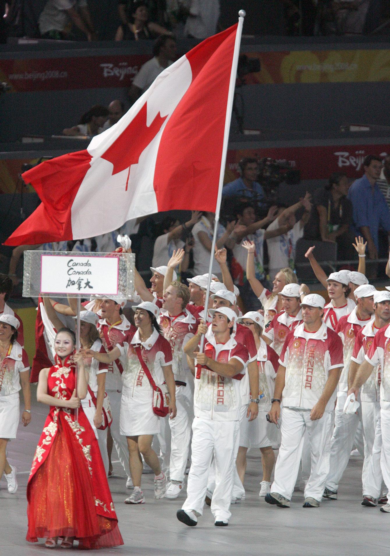 Adam van Koeverden leads Canada into the Bird's Nest at Beijing 2008 Opening Ceremony.