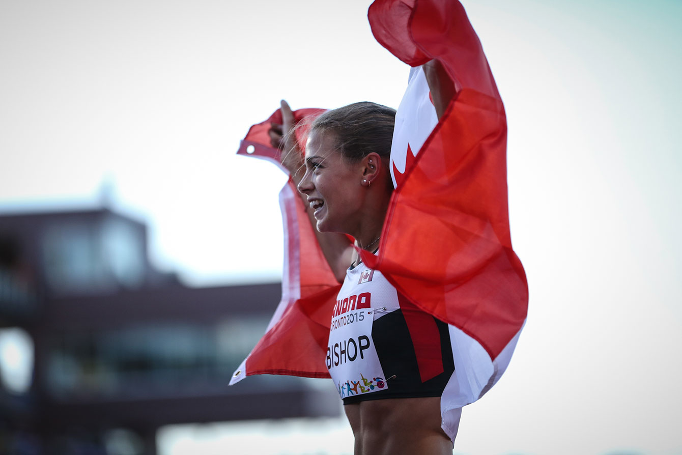 Melissa Bishop takes a victory lap with the Canadian flag after winning the women's 800m at the Pan Am Games on July 22, 2015.