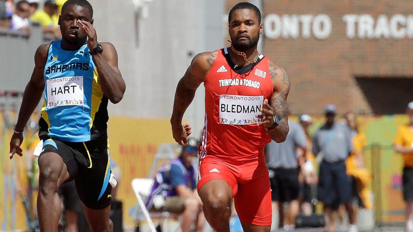 Keston Bledman (right) sprints away during Pan Am Games heats in Toronto on July 21, 2015.