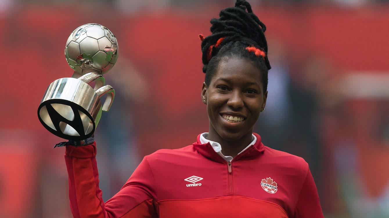 Kadeisha Buchanan holds up the best young player award from 2015 FIFA Women's World Cup.