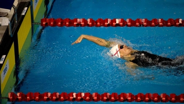 Canada's Hilary Caldwell reaches for the wall to win the women's 200m backstroke.