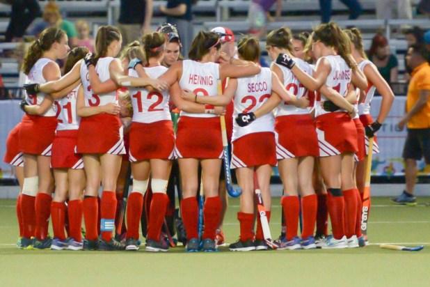 Team Canada's women's field hockey team in a huddle