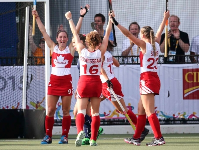 Canada's Women's Field Hockey team cheering during the Bronze Medal Game