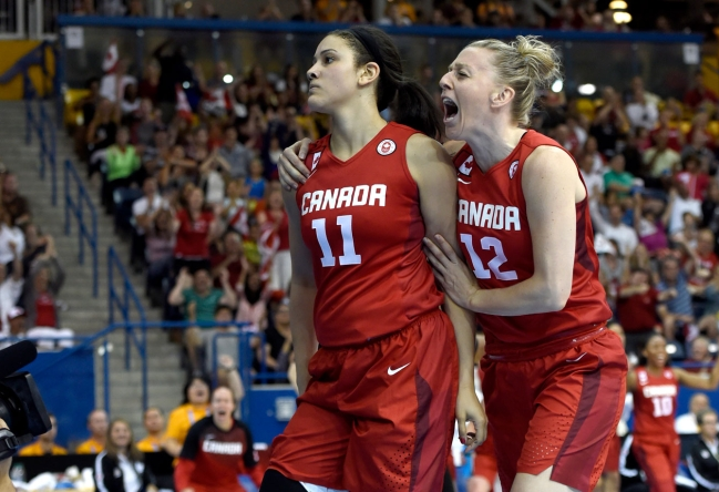 Natalie Achonwa (11) and Lizanne Murphy celebrate against USA in Pan Am Games basketball gold medal final on July 20, 2015.