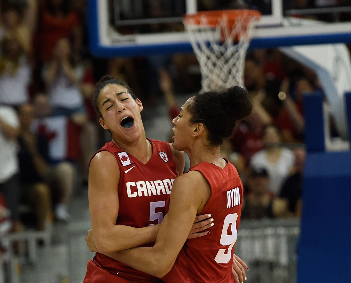 Kia Nurse (left) and Miranda Ayim celebrate during the gold medal game versus the United States at TO2015.