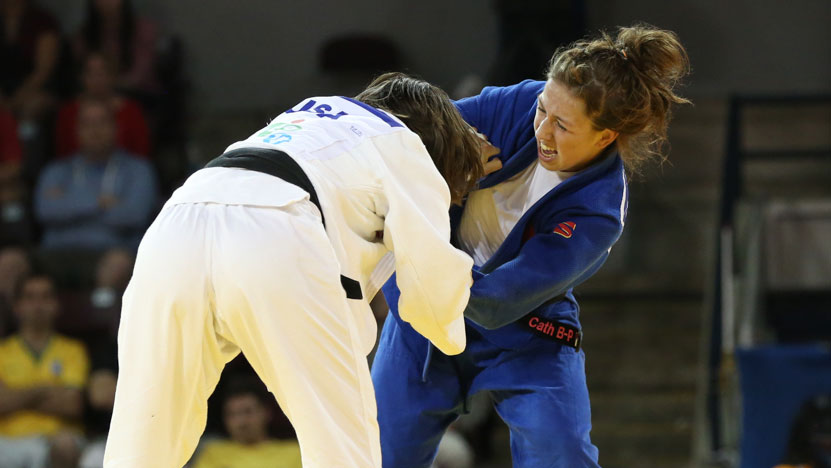 Catherine Beauchemin-Pinard (blue) and Marti Malloy of the United States in their Pan Am Games gold medal bout on July 12, 2015.