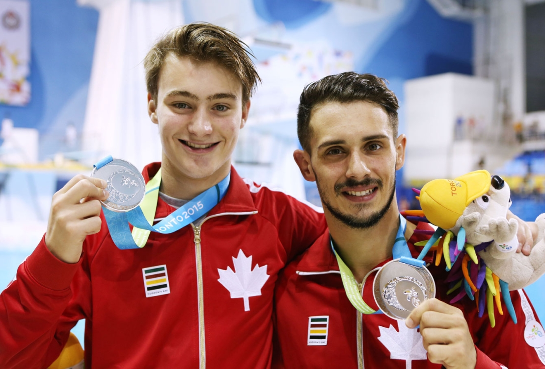Philippe Gagné (left) and partner François Imbeau-Dulac are all smiles after winning silver in synchronized 3m springboard. (Phot: Vaughn Ridley)