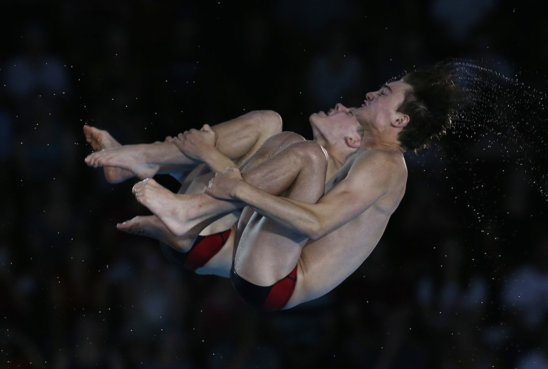 Philippe Gagne and Vincent Riendeau of Canada compete in the Men's 10m Synchro Final. Photo by Vaughn Ridley.